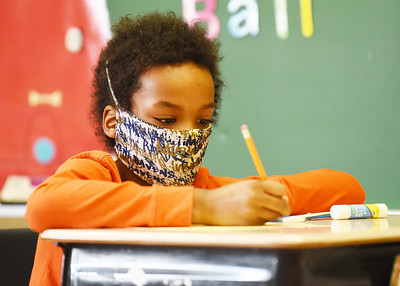 Xandyn Morgan, a third grader at Emily Brittain Elementary, works on his Martin Lutheran King project in class Friday, January 15, 2021. Harold Aughton/Butler Eagle.
