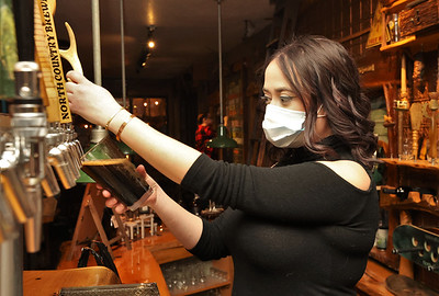 Bartender Hannah Cavanaugh pours a beer Friday at North Country Brewery in Slippery Rock Friday. 01/15/20