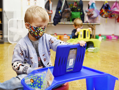 Pre-schooler Seven Mesanko, 4, examines his work during a recent class at Butler Catholic.. The school has launched a technology program in which students use iPads and Chromebooks for remote and in-class instruction. Harold Aughton/Butler Eagle.