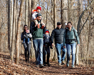 With his son Harrison,3, on his shoulders, Noah Zajac of Prospect leads friends on a hike at Jennings Environmental Center Saturday. The center hosted a self-guided tree identifying walkabout Saturday as part of it's Covid-safe program offering.  Seb Foltz/Butler Eagle 01/09/20