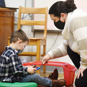 Pre-schooler Bradley Steward, 3, works with teacher Shannon Dorcy during a recent class at Butler Catholic.. The school has launched a technology program in which students use iPads and Chromebooks for remote and in-class instruction. Harold Aughton/Butler Eagle.