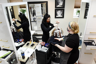 Butler Beauty student Claudie Sloboda of West Sunbury works on a client with the help of teacher Mandy Bayne. Harold Aughton/Butler Eagle.