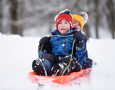 Brothers Aaron, 6, and Adam, 3, Steiner of Cranberry Twp. spent Monday morning sled ridding with their dad, Andrew Steiner at North Boundary park . January 18, 2021. Harold Aughton/Butler Eagle