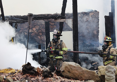 Firefighters from Unionville and a number of area fire departments respond to a house fire north of Moraine State Park Tuesday. Seb Foltz/Butler Eagle 01/19/20