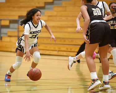 Knoch's Nina Shaw, #25, prepares to make her move on Highland's #20 Monday, January 11, 2021. Harold Aughton/Butler Eagle.