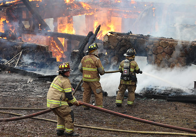Firefighters from Prospect and a number of area fire departments respond to a house fire north of Moraine State Park Tuesday. Seb Foltz/Butler Eagle 01/19/20