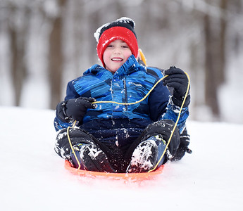 Brothers Aaron, 6, and Adam, 3, Steiner of Cranberry Twp. spent Monday morning sled ridding with their dad, Andrew Steiner at the North Boundry park. January 18, 2021.