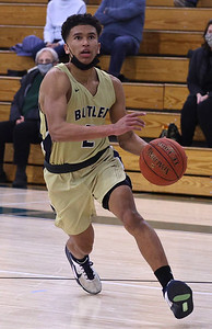 Butler's Devin Carney drives to the hoop against Pine Richland Tuesday. Carney scored his 1,000th point in the 65-61 road loss. Seb Foltz/Butler Eagle 01/19/21