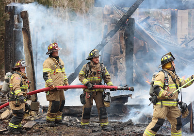 Firefighters from Slippery Rock and a number of fire departments respond to a house fire north of Moraine State Park Tuesday. Seb Foltz/Butler Eagle 01/19/20