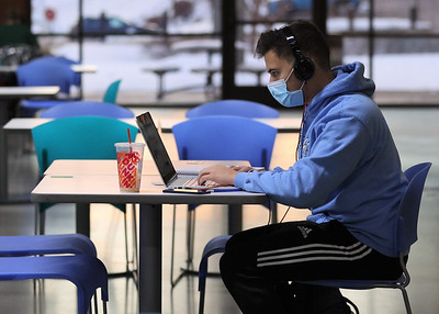 Slippery Rock University senior Zach DeTemple works on his laptop in the mostly empty Robert M. Smith Student Center Wednesday. Seb Foltz/Butler Eagle 01/20/21