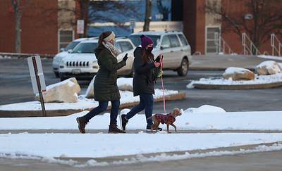 Slippery Rock University students walk through a mostly empty campus Tuesday. Seb Foltz/Butler Eagle 01/20/21