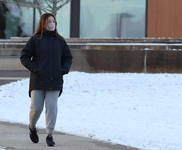 A Slippery Rock University student walks to the Boozel Dining Hall Wednesday. Seb Foltz/Butler Eagle 01/20/21