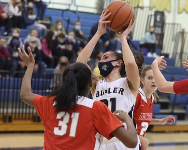 Butler's Alison Altman extends for a shot at home against North Hills. Butler topped the Indians 52-26. Seb Foltz/Butler Eagle 01/21/21