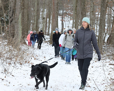 Martha Walton and her dog Koda lead a group of hikers from the Adventure Ladies Cranberry Facebook group Saturday in Preston Park Saturday. The women's group meets every two weeks to hike at different locations around the region. Seb Foltz/Butler Eagle 01/23/21