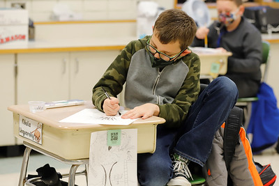 Northwest Elementary fourth grader Niko Unguarsky, 10, works on an water color project in Gretchen Lavery's art class Friday. Seb Foltz/Butler Eagle 01/22/21