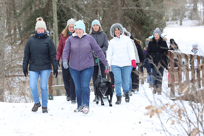 Michelle Deemer (center) and Shawna Bostaph(left) lead a group of hikers from the Adventure Ladies Cranberry Facebook group Saturday in Preston Park Saturday. The women's group meets every two weeks to hike at different locations around the region. Seb Foltz/Butler Eagle 01/23/21