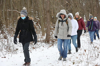 Val Hogan of Butler (left) and Kathy Rojas of Adams Township lead a group of hikers from the Adventure Ladies Cranberry Facebook group Saturday in Preston Park Saturday. The women's group meets every two weeks to hike at different locations around the region. Seb Foltz/Butler Eagle 01/23/21