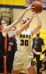 Fox Chapel's Elsie Smith blocks a shot attempt by Mars Olivia Donnelly in the fist period Monday, January 25, 2021. Harold Aughton/Butler Eagle.