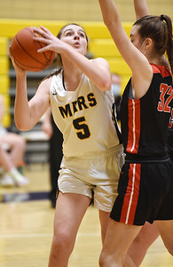Mars Ava Black (5) attempts a shot against Fox Chapel's Elsie Smith (32) in the third period, Monday, January 25, 2021. Harold Aughton/Butler Eagle.
