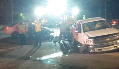 Emergency responders work to clear the scene of a two-vehicle accident on Route 8 at the entrance to the Clearview Mall at 6:30 p.m. Monday. The female driver of the car was transported to Butler Memorial Hospital with a minor head injury.