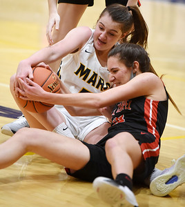 Mars Ava Black (5) fights for a loose ball with Fox Chapel's Domenica Delaney (10) in the first period, Monday, January 25, 2021. Harold Aughton/Butler Eagle.