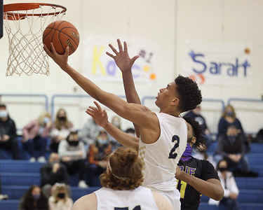 Butler's Devin Carney extends for a layup against Erie. Carney logged 39 points in the 86-78 Butler win. Seb Foltz/Butler Eagle 01/25/21