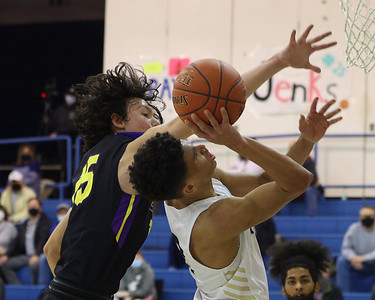 Butler's Devin Carney attempts a shot over a block attempt by Erie's Stephen Scheppner. Carney logged 39 points in the 86-78 Butler win. Seb Foltz/Butler Eagle 01/25/21