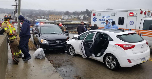 Butler police and firefghters along with Butler Ambulance Service respond to a two-vehicle crash about 10:50 a.m. Tuesday on South Monroe Street at Lookout Point Bridge in Butler. One person was injured in the wreck.