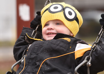 Jaxson Taylor, 3, of Butler took to the swings in Rotary Park with his sister, Sophie Taylor, 2, and his father, Jerry Taylor Wednesday, January 27, 2021.