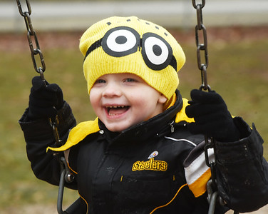 Jaxson Taylor, 3, of Butler took to the swings in Rotary Park with his sister, Sophie Taylor, 2, and his father, Jerry Taylor Wednesday, January 27, 2021. Harold Aughton/Butler Eagle