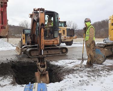 Utility crews work on a water line on North Washington St. in Evans City Thursday. Seb Foltz/Butler Eagle 01/28/21