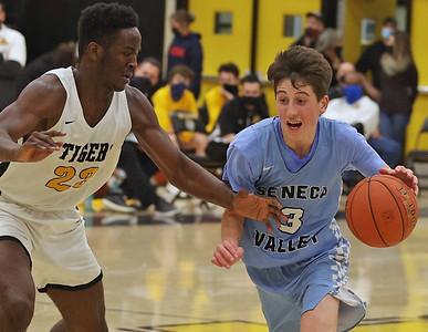 Seneca Valley's Cole Brooks drives down court against North Allegheny's Khalil Dinkins in Friday's 78-77 loss at NA. Seb Foltz/Butler Eagle 01/29/21