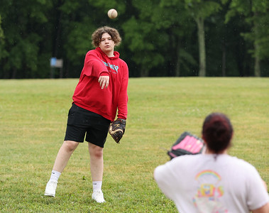 Espen Bonfardine plays catch Tuesday at Alemeda Park. A group of Butler County locals joined a national effort to break Guinness Book of World Records record for the number of people playing catch. Seb Foltz/Butler Eagle 06/30/21