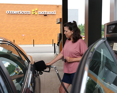 Marie Srock of Mars fills up gas in her daughter's car at the American Natural gas station at the intersection of Route 8 and 228. Seb Foltz/Butler Eagle 06/30/21