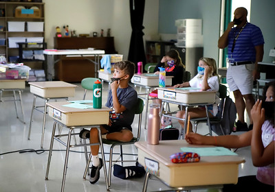 Northwest Elementary School student Jude Bartholic looks up at the board Tuesday during Chris Morrow's third grade math class. Morrow's class was moved to the music room in order to accomodate social distancing and keep from splitt Seb Foltz/Butler Eagle 09/08/20