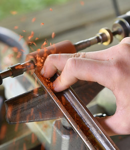 Jon Crowley, 15, of Slippery Rock uses a lathe to make the barrel of a wooden pen at Edco Park in Evans City Friday, July 2, 2021. Harold Aughton/Butler Eagle.