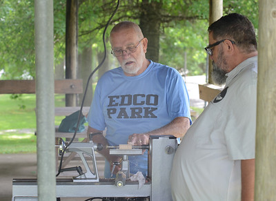 Bowls for Good founder Ben Farrell and Evans City Borough Mayor Dean Zinkhann make pens at EDCO Park and Pool. photo: Julia Maruca