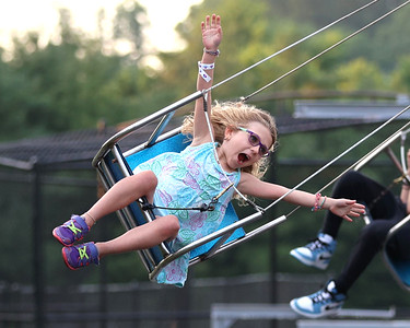 Ellie Sunderlin,5, enjoys a ride on the swings at Seven Fields' Community Days Thursday. The annual fair made it's return following a COVID-related hiatus last summer. It runs through Saturday. Seb Foltz/Butler Eagle 07/02/21
