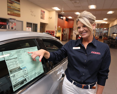 Diehl Toyota sales consultant Amy DeAugustine points out features on a new Toyota Avalon hybrid in Diehl's Route 8 showroom. Seb Foltz/Butler Eagle