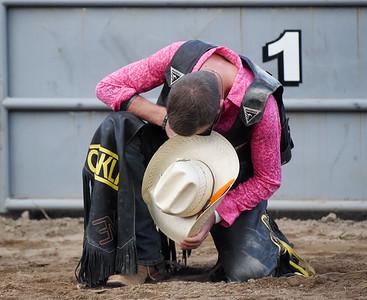 A cowboy bows his head in prayer before the Bullride Mania event at the Big Butler Fair Saturday. Harold Aughton/Butler Eagle.