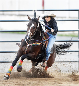 Abby Lynn, 21, of Freeport competed in the barrel racing contest with her horse, Cookie, during Bullride Mania at the Big Butler Fair Saturday evening. Harold Aughton/Butler Eagle.