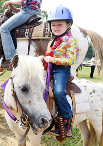 Lakin Palmer, 5, of Slippery Rock took seonc place with her horse Lady Bug during the Poll Bending competition at the Butler Fair Monday morning. Harold Aughton/Butler Eagle.