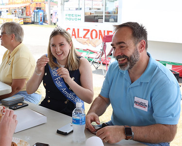 Pennsylvania Supreme Court candidate Kevin Brobson sits and talks with Big Butler Fair ambassador Jillian Ranko, Brobson's daughter Claire Brobson (not pictured) and other officials from the fair. Brobson was at the fair Tuesday for a campaign stop and tour with fair staff. Seb Foltz/Butler Eagle 07/06/21