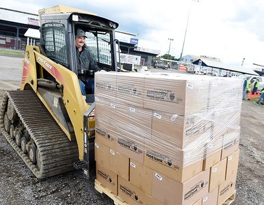 Rich Wise of Chicora volunteered running a skid loader moving pallets of food at the Pittsburgh Food Bank distribution held at Lernerville Speedway, Tuesday morning. Harold Aughton/Butler Eagle