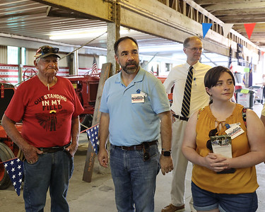 Pennsylvania Supreme Court candidate Kevin Brobson (center) and his daughter Claire Brobson get a tour of the Big Butler Fair's antique display from fair director Harold Kennedy Tuesday with state senator Scott Hutchinson (back). Brobson was at the fair Tuesday for a campaign stop and tour with fair staff. Seb Foltz/Butler Eagle 07/06/21