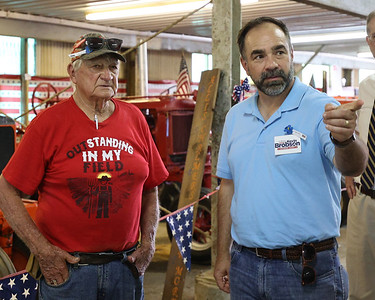 Pennsylvania Supreme Court candidate Kevin Brobson (right) and his daughter Claire Brobson (out of the picture) get a tour of the Big Butler Fair's antique display from fair director Harold Kennedy Tuesday. Brobson was at the fair Tuesday for a campaign stop and tour with fair staff. Seb Foltz/Butler Eagle 07/06/21