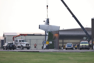 Storm damaged plane being lifted at the Butler Airport.