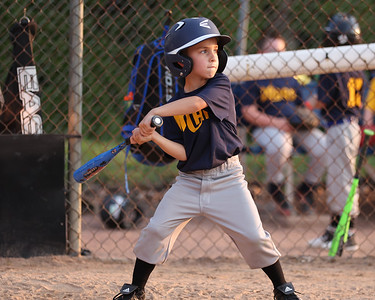 Dominic Ulintz takes a swing at a pitch in a Mars Area 6-8-year-old coach-pitch game Tuesday.  (Fields by the Mars admin building). Seb Foltz/Butler Eagle 07/06/21