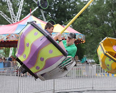 Jayce McGowan, 6, and his grandfather Pat Keeley ride the tea cup swing ride at Cranberry Community Days Thursday. The township fair opened Thursday and runs through Saturday. Seb Foltz/Butler Eagle 07/08/21