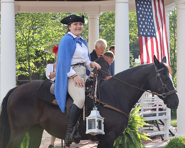 Josie Paul plays Paul Revere during the finale for the Zelienople Historical Society's Patriotic Porch Tour week celebration Thursday at the Passavant House. Seb Foltz/Butler Eagle